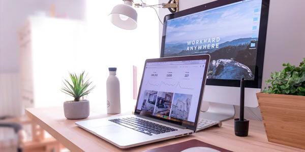Laptop and desktop on a desk