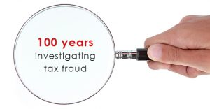 "Photo reads ""100 years investing tax fraud."" Text is under a microscope."